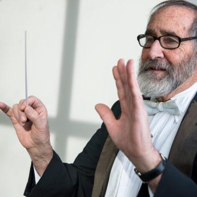 Professor Joel Glickman conducts an orchestra.