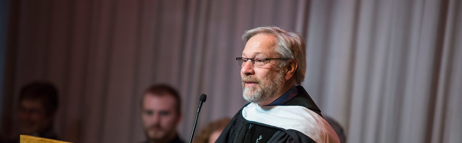 Chaplain David Saetre at podium