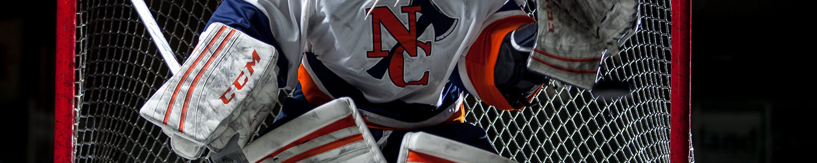 Northland College goalie blocks puck