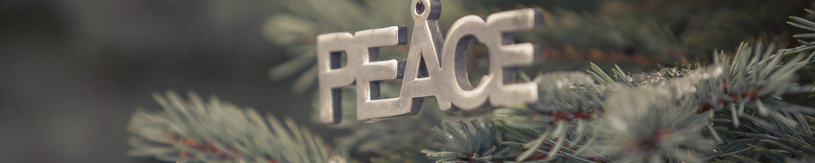 Christmas ornament that spells out PEACE