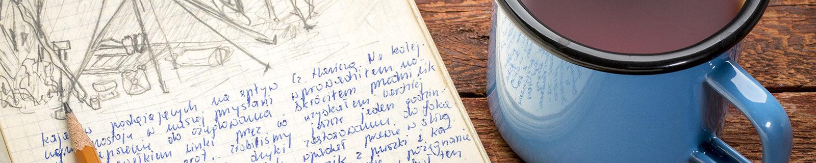 Writing journal and coffee mug