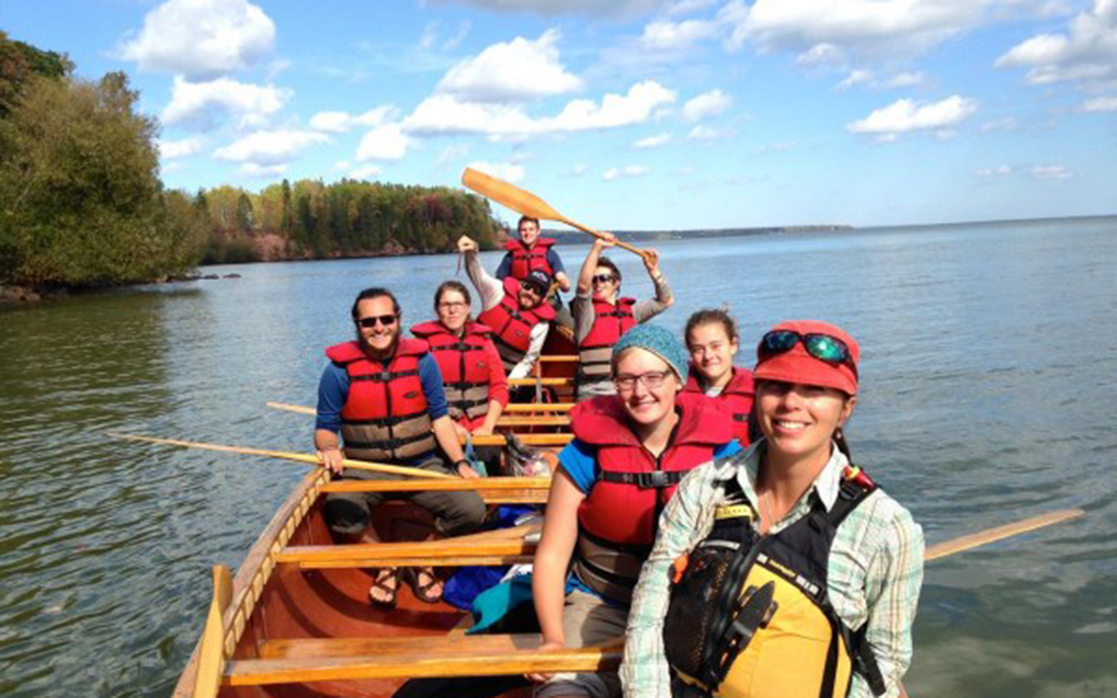 Northland College Professor Elizabeth Andre with students in a voyageur canoe