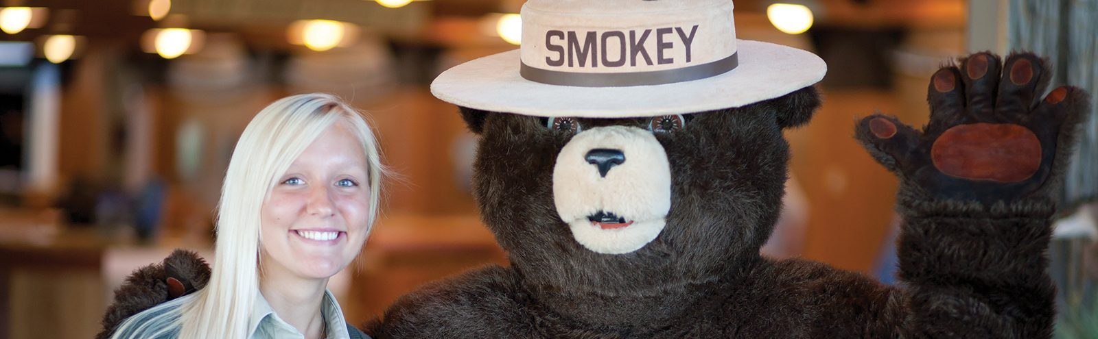 Girl with Smokey the Bear