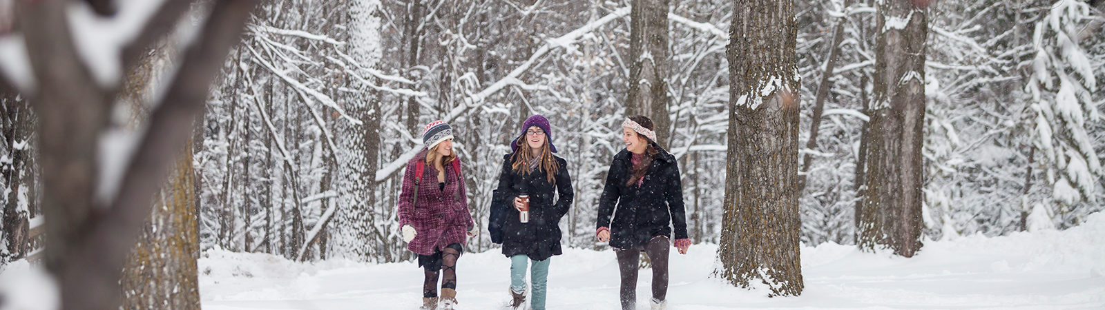 Snowy campus with students walking