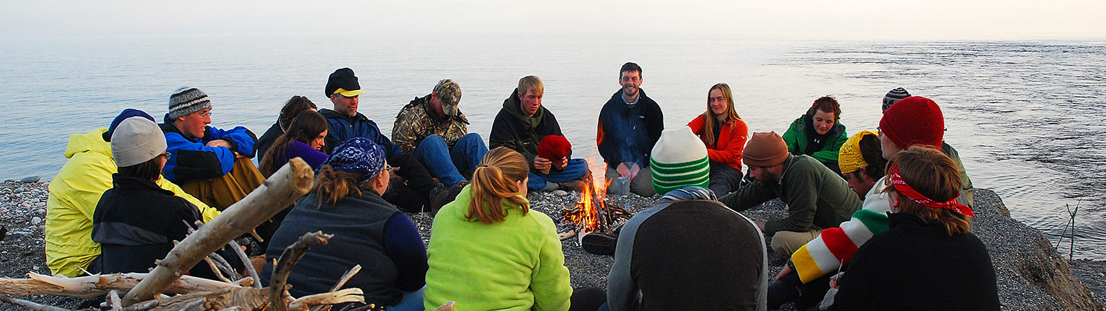 Superior connections students around a fire