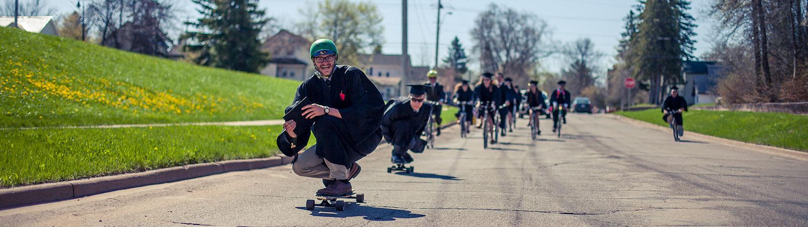 students skateboarding at graduation
